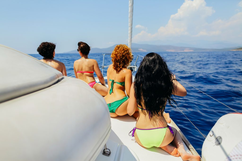 Group Of Women Yachting Sea
